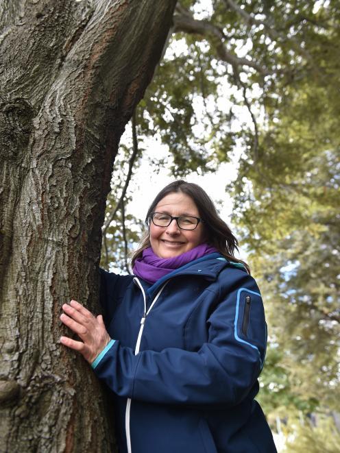 Associate Prof Janice Lord with a native beech tree. Photo: Gregor Richardson