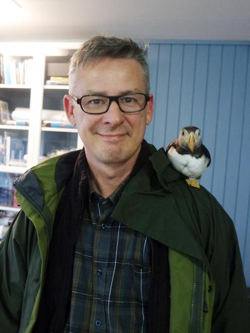 Dr Erpur Hansen, director of the South Iceland Nature Research Centre with Toti the puffin. Photo...