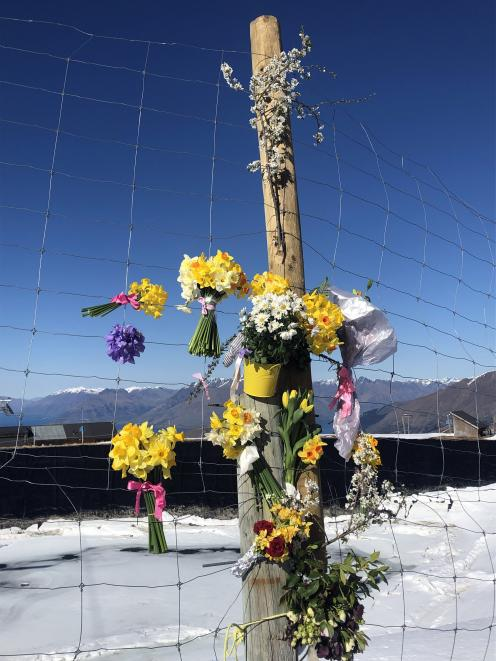 Flowers were laid to remember the woman who died in a skiing accident at Coronet Peak on Saturday. Photo: Supplied