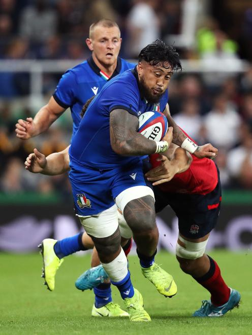 Italy loose forward Jimmy Tuivaiti attempts to break clear against England at St James' Park in...