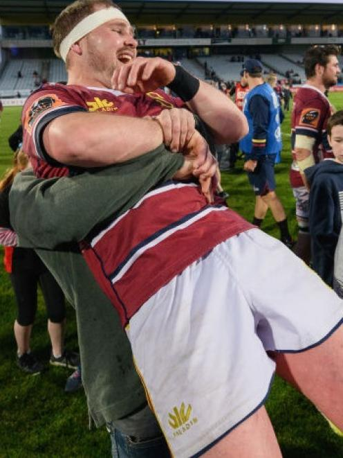 Southland's Ryan Carter gets a hug from a jubilant supporter after the game. The Stags' 42-14 win...