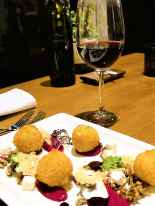 The Ake Ake 2018 Chambourcin was a tasty complement to the goat's cheese croquette entree. PHOTO:...