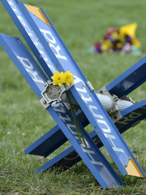 Floral tributes have been placed at the scene of Tuesday's fatal crash near Outram. Photo: Staff Photographer