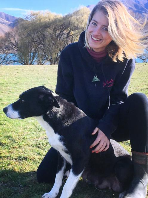 English shepherd and lamb-rearing Sophie Barnes with Fern on the shores of Lake Aviemore in the...