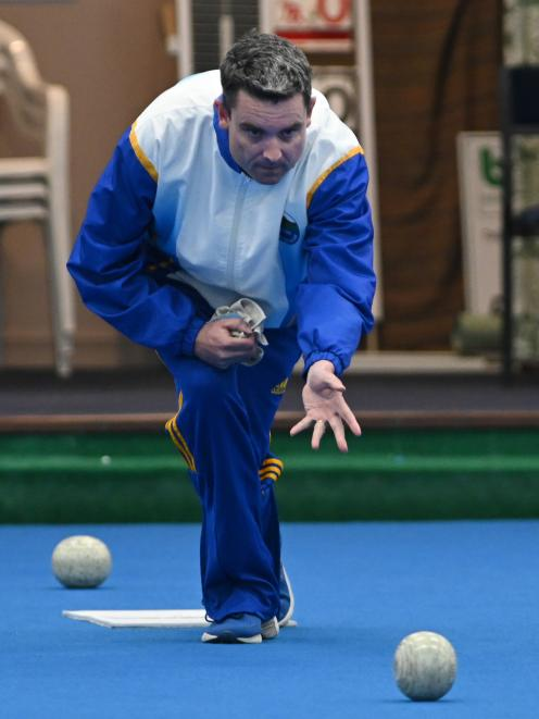 Andy McLean delivers a bowl at the final of mixed pairs bowling competition at the Dunedin Lawn Bowls Stadium last night