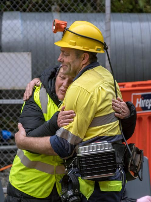 Anna Osborne and Scotty Campbell have a hug at the Pike River Mine portal yesterday. PHOTO:...