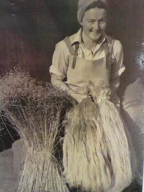Methven's Phyllis Manning holds scutched linen flax fibre from the Methven factory in this 1946...