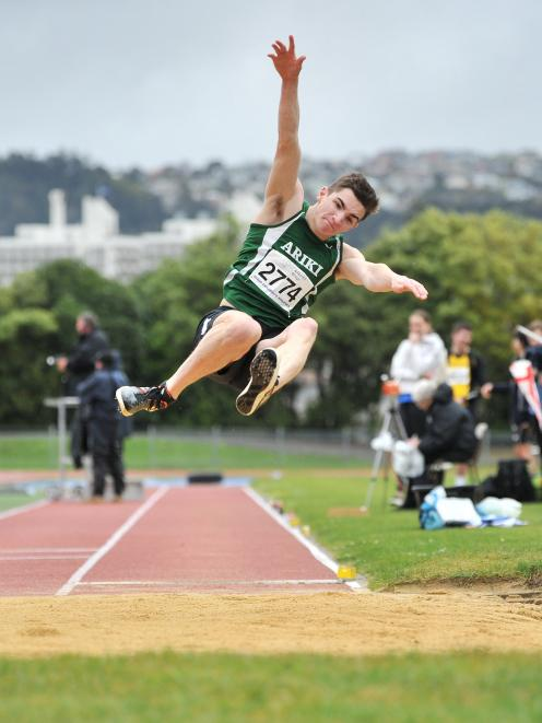 Ariki's Shay Veitch flies through the air during his winning long jump performance at the...