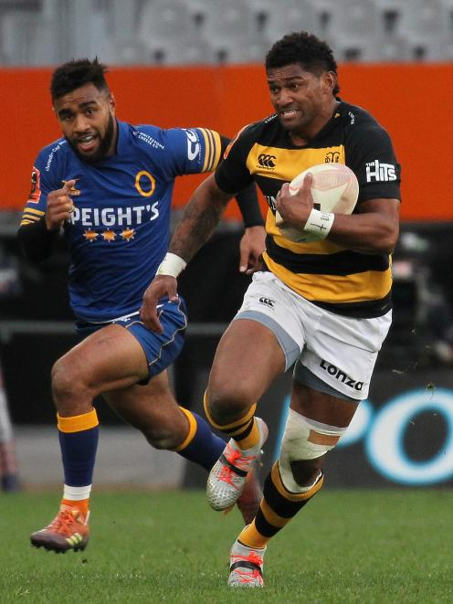 Waisake Naholo, playing for Taranaki against Otago last month, runs hard at Forsyth Barr Stadium, as Jona Nareki gives chase. Photo: Getty Images