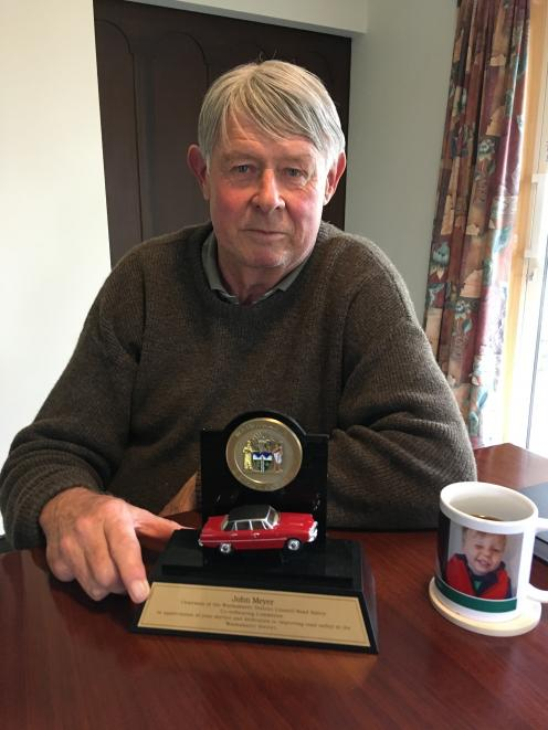 John Meyer received a special trophy depicting his Rover P6B, in recognition for serving as chairman of the Waimakariri District Council's road safety committee for the last nine years. Photo: David Hill