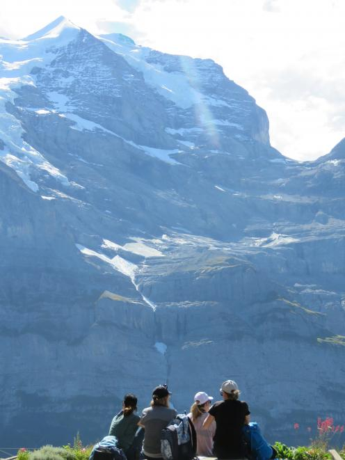 Dwarfed by the mighty Jungfrau on day two. PHOTO: SUPPLIED