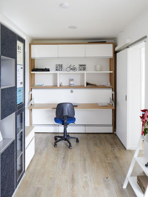 The office converts into a second bedroom (below)