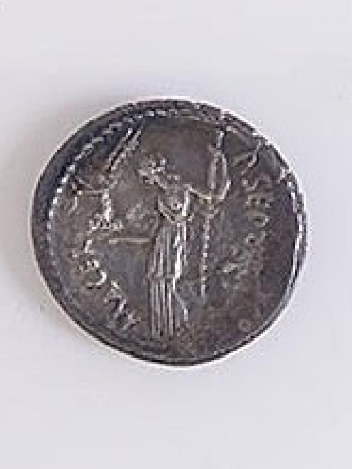 Both sides (above and below) of a Julius Caesar denarius, minted in January-February BC44. At...