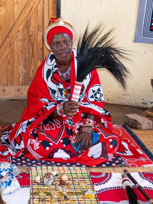 Nosia Sibiya, a shaman in Hamilton Village, rolls the knucklebones for visitors seeking answers....