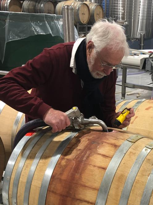 After 38 years of grape growing and winemaking in Central Otago, Alan Brady, of Clyde, fills barrels with some of his 2019 Wild Irishman Pinot Noir, in April. Photo: Alan Brady