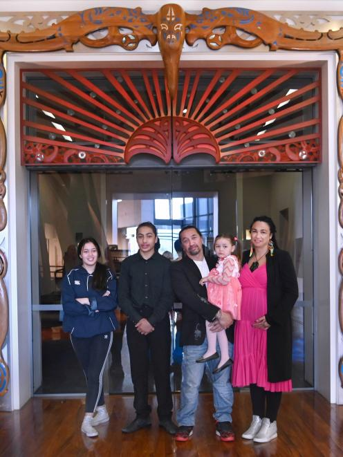 Master carver James York and family members (from left) Mia Wereta (15),Nukuroa McLean (15), Aniwa York (4), and Amber Bridgman take a moment to reflect under Te Ohaka a Toroa(The Nest of the Albatross), at Toitu Otago Settlers Museum shortly after the un