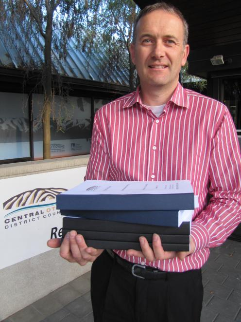 Central Otago District Council planning manager David Campbell holds the 2199-page agenda for the...