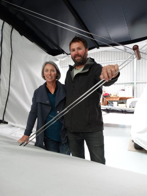 Callum Smith and wife Trish Wrigley with one of the Staggerwing aircraft they have been working...