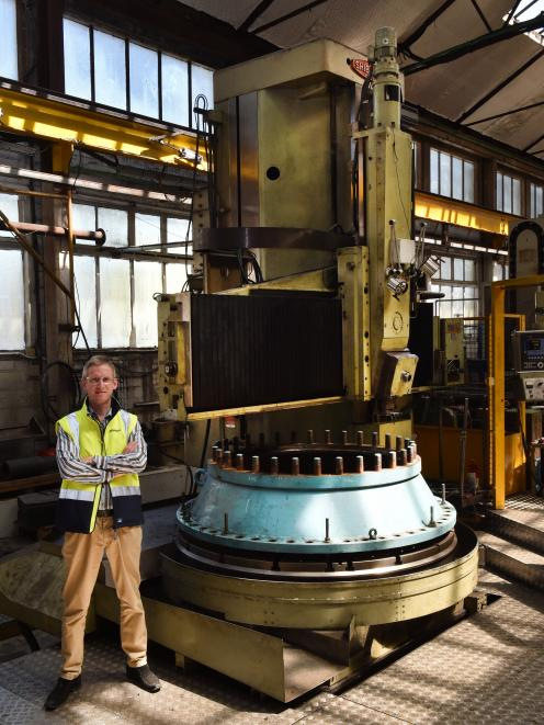 Farra Engineering chief executive Gareth Evans with a vertical lathe, working on a main input valve from Waipori Power Station. Photo: Gregor Richardson