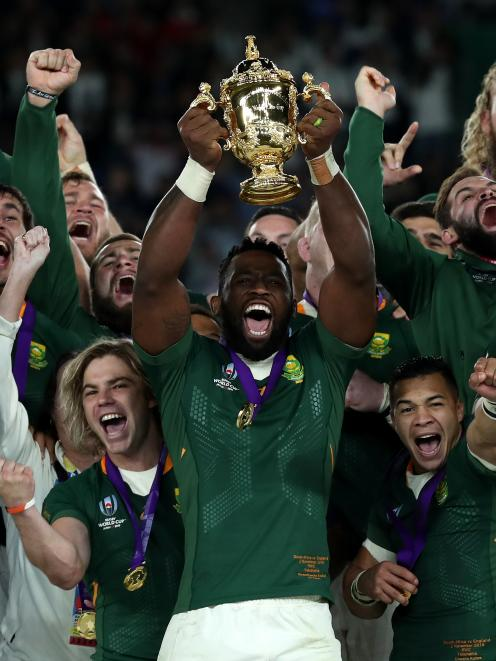 South African captain Siya Kolisi raises the Webb Ellis Cup after their victory in the Rugby...