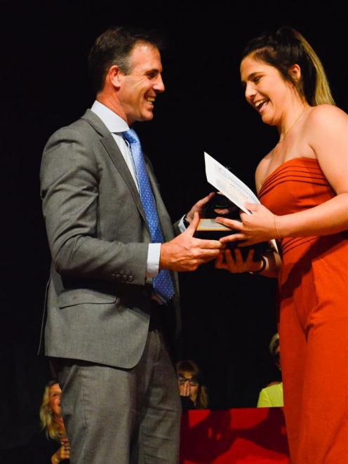 Oxford Area School dux Ellie Tizzard is congratulated by principal Mike Hart.