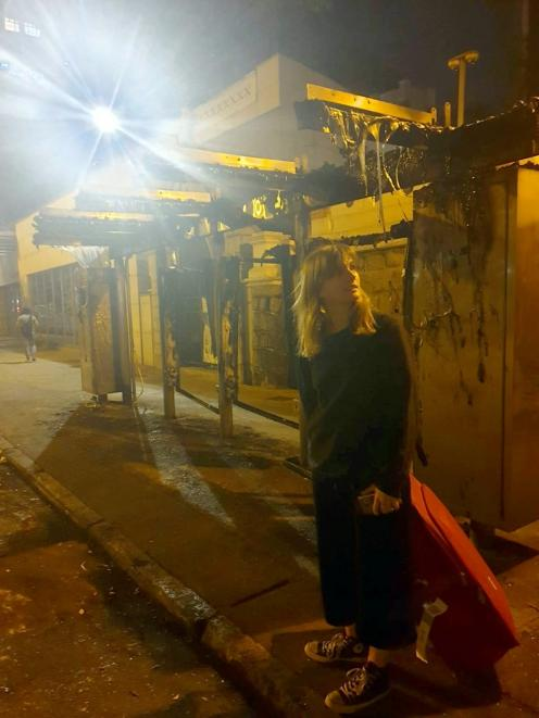 Jacqui Margetts, who has New Zealand citizenship and Hong Kong residency, stands at a burnt-out...