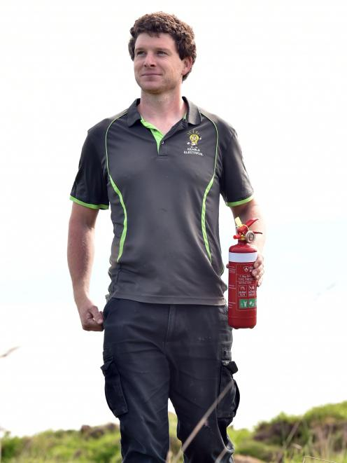 Justin Keable, and his trusty fire extinguisher, were on hand to help put out a grass fire in...