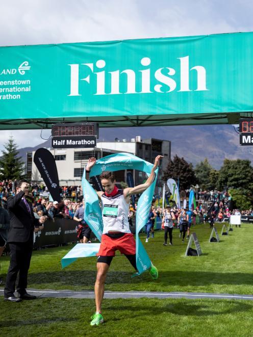 Men's winner Fabe Downs crosses the line.