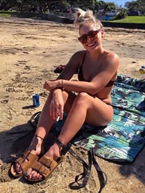 An image posted by Rouxle Le Roux on social media, showing her at the beach while wearing an...