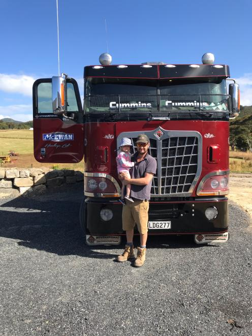 Nic McEwan with daughter Polly (2). Versatility in the way his trucks can be configured has been key to gaining efficiencies, he says. Photo: Julia McEwan