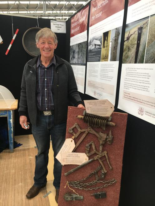Ken Gillespie was helping out on the Heritage New Zealand site at the New Zealand Agricultural Show last month to raise awareness of archaeological items on farms. This Pollard cutter was once used for rabbit control in South Canterbury. Photo: David Hill