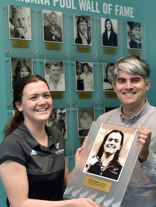 Dunedin swimmer Erika Fairweather and Dunedin Mayor Aaron Hawkins at Moana Pool yesterday with the latest addition to the pool's wall of fame. Photo: Peter McIntosh