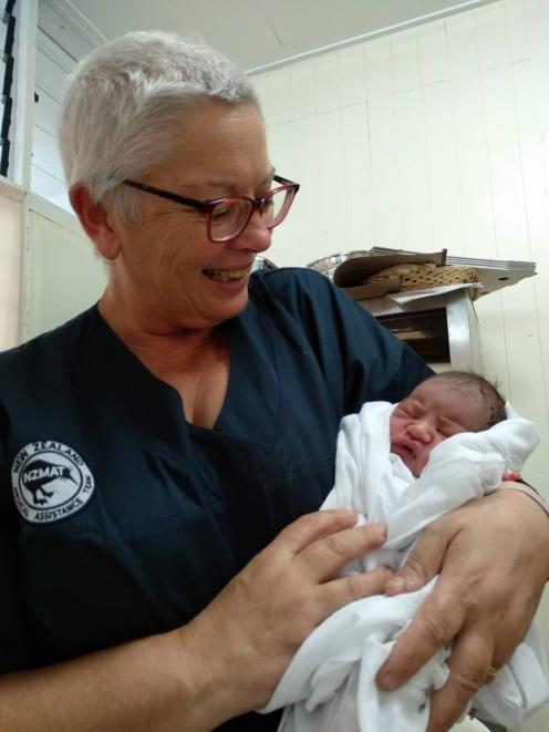 Invercargill nurse Anne Dymond holds baby Annegelo — a baby she delivered while at Leulemoega Hospital in Samoa while helping with the measles epidemic. Photo: Supplied