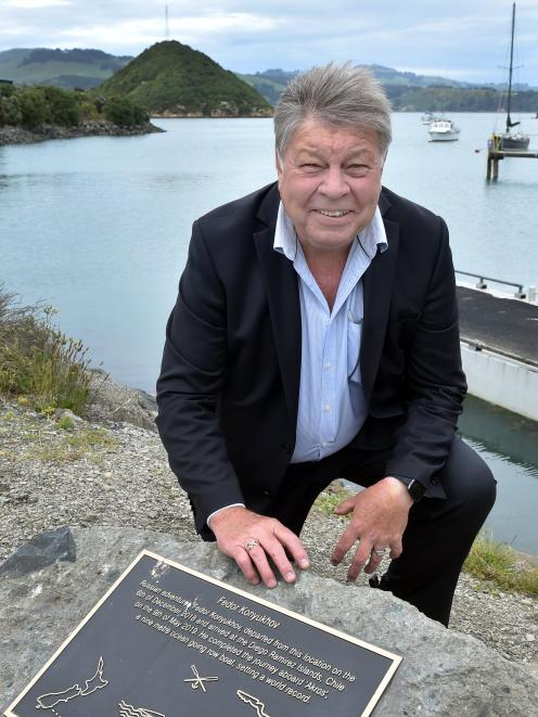 Enterprise Dunedin business relationship manager Des Adamson crouches near the Port Chalmers Yacht Club at Peninsula Beach Rd, at the point where explorer Fedor Konyukhov set off on his voyage to Chile. Photo: Peter McIntosh