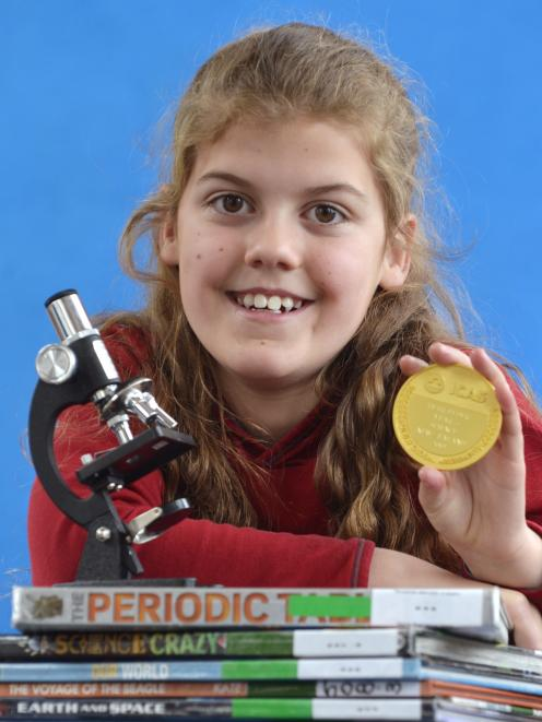 George Street Normal School pupil Beth Elder proudly displays the gold medal she won for gaining New Zealand's top mark in the recent University of New South Wales International Competitions and Assessments for Schools (ICAS) year 5 science exam. Photo: G