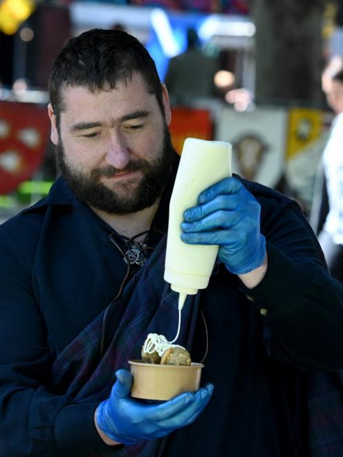 Bracken Restaurant owner Dave Burt drizzles whisky mayonnaise on to haggis balls.