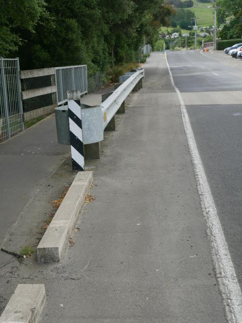 Concrete sleepers are positioned on the northern side of the bridge in Cemetery Rd, but not  the...