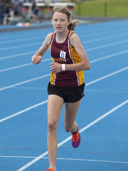 Amelia Henstock, 11, of the Christchurch Avon Athletics Club, is first across the line in the...