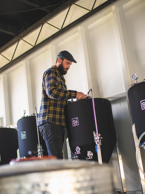 Jono Walker, of Arc Brewery, prepares another satisfying drop. Photo: Supplied
