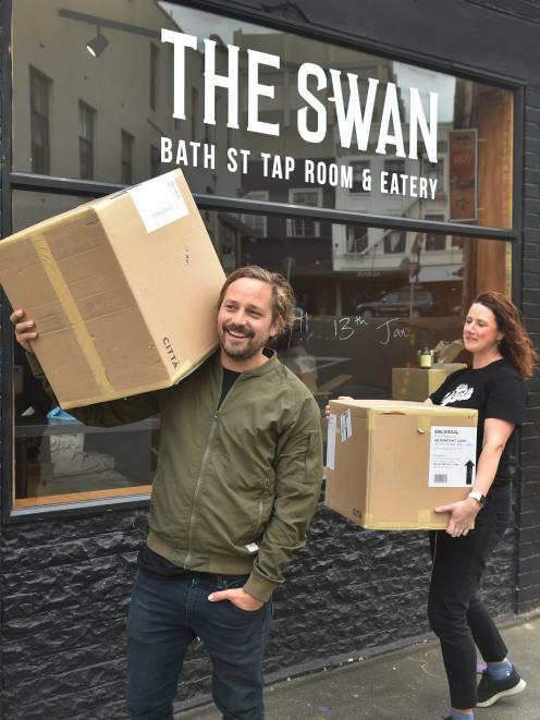 Patrick Hussey and Sarah Hussey are getting everything ready for The Swan's soft opening tonight. Photo: Peter McIntosh