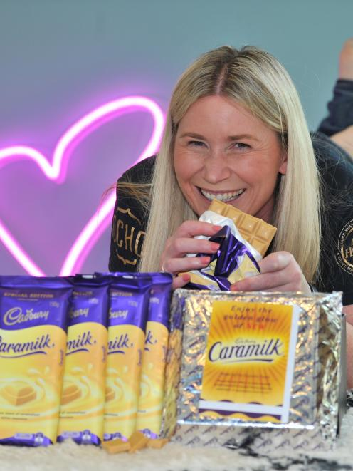 Former Cadbury worker Megan Fairley sells the last 20 blocks of Dunedin Caramilk, plus a 1kg slab, to raise money for the Australian bushfires. Photo: Christine O'Connor