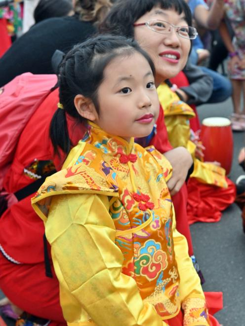 Monica Zhang (8) and her mother Susan Xu participate in activities at the Dunedin Chinese Garden.