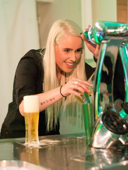 Thomas Green Public House and Dining Room assistant manager Sarah Ewing, of Gore, pulls a second...