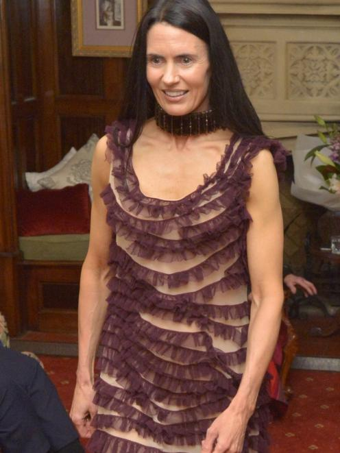 Bridget, from Silver Fox MGMT, is modelling a beige mesh and purple ruffled John Paul Gaultier...