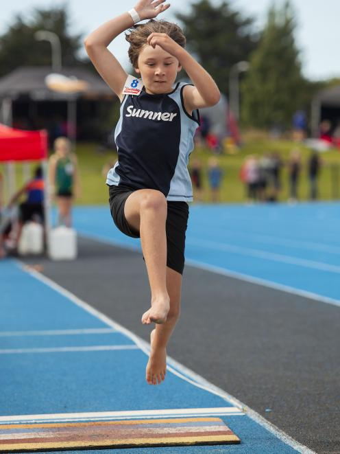 Ben Lamborn, 8, of the Sumner Running Club, competes in the boys long jump grade 8 div 1, 2, 3....
