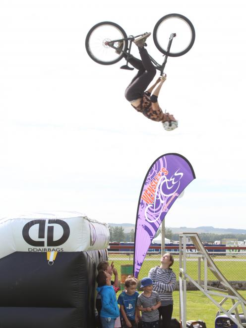 Andrew Nilbett entertains at the Winton A&P Show on Saturday by performing stunts in front of,...