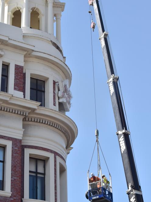 An inspection is carried out on Dunedin's Allied Press building yesterday after masonry fell on...