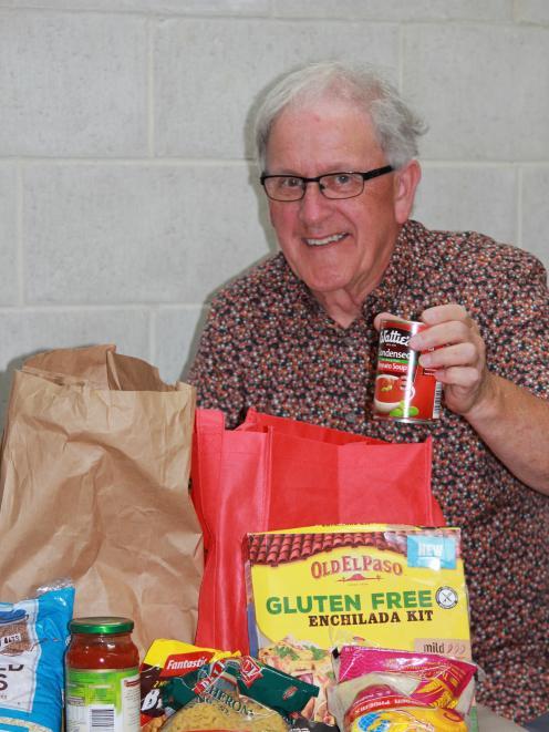 Society of St Vincent de Paul Dunedin volunteer Charlie Pringle packs another food parcel for a...