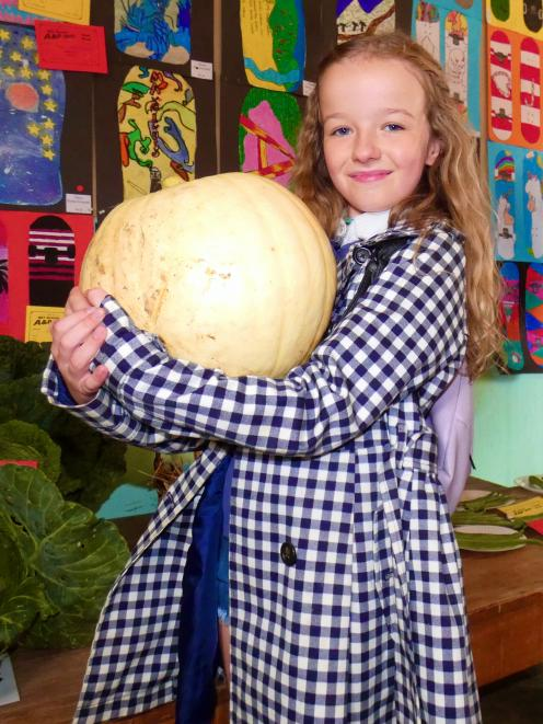 Showing off her prize-winning pumpkin is Marissa Crawford, of Roxburgh. PHOTO: SIMON HENDERSON