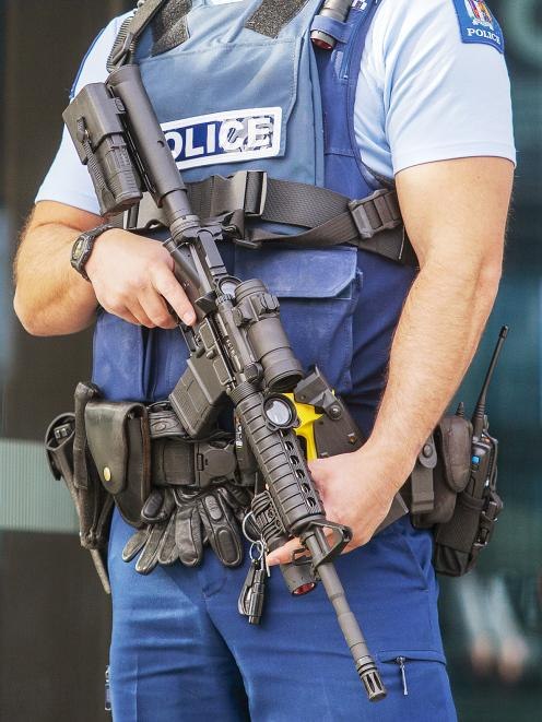 Armed police outside the Justice and Emergency Services Precinct. Photo: Geoff Sloan